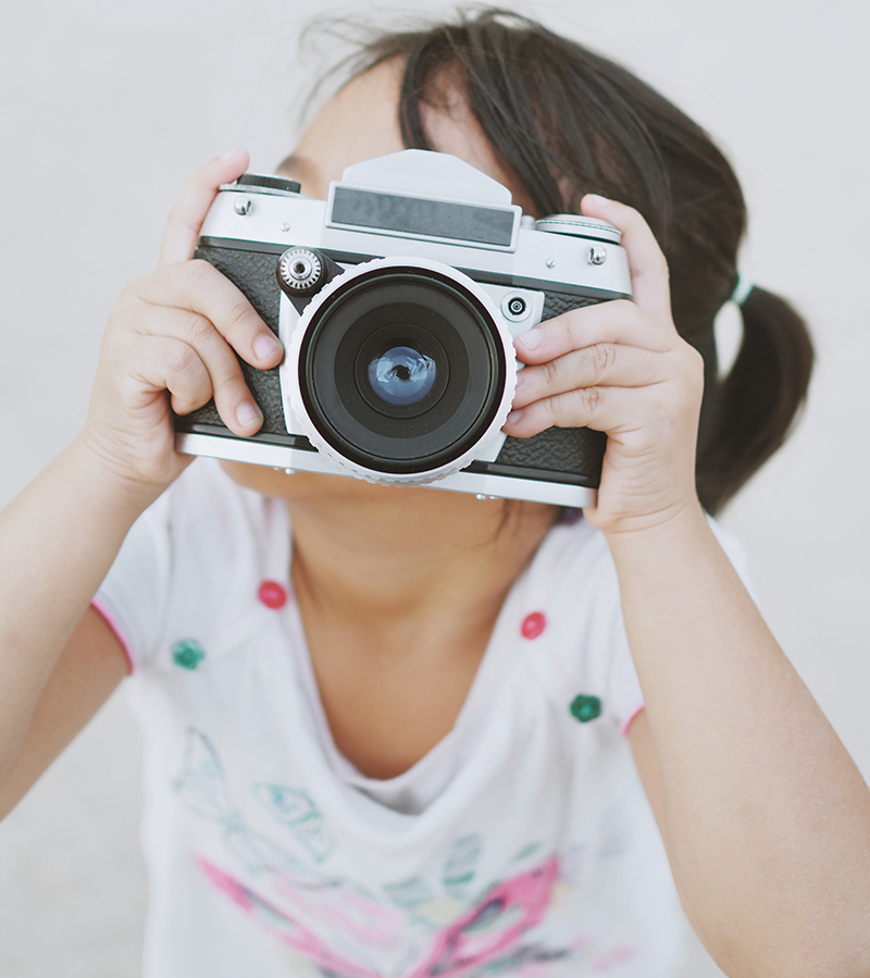 vintage camera with little girl in vintage color tone